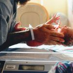 What is premature birth? Baby feet in an open incubator