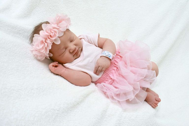 Contact us Baby girl in pink tutu